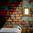 Picture frame on the old brick wall — Stock Photo