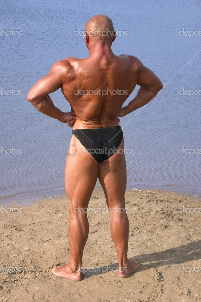 Strong man posing at the beach — Stock Photo #4217282