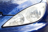 Blue car front light — Stock Photo