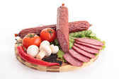 Sliced sausage with vegetables — Stock Photo