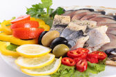 Fresh fish on dish with vegetables — Stockfoto