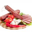 Royalty-Free Stock Photo: Sliced sausage with vegetables and red papper