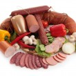 Sliced sausages with vegetables and red papper — Stock Photo