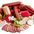 Stock Photo: Sliced sausages with vegetables and red papper