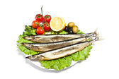 Fish with lemon on plate — Stock Photo