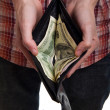 Man shows purse with dollars — Stock Photo