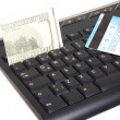 Computer keyboard and credit card with dollars — Foto Stock