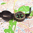 Compass and globe - travel concept - Stock Photo