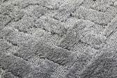 šedý koberec pozadí — Stock fotografie
