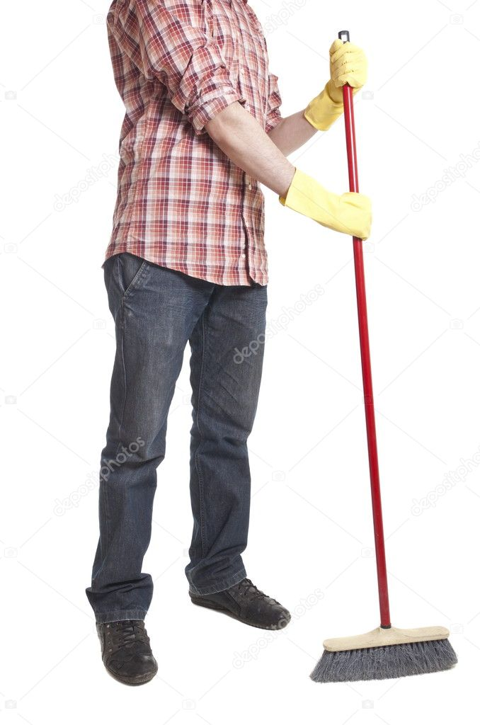 Full isolated studio picture from a young worker with a broom  Stock Photo #5224970