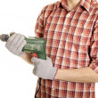 Hands handling an electric drilling machine — Stockfoto