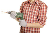 Hands handling an electric drilling machine — Stock Photo