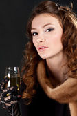 Woman in an night dress with a champagne glass — Stock Photo