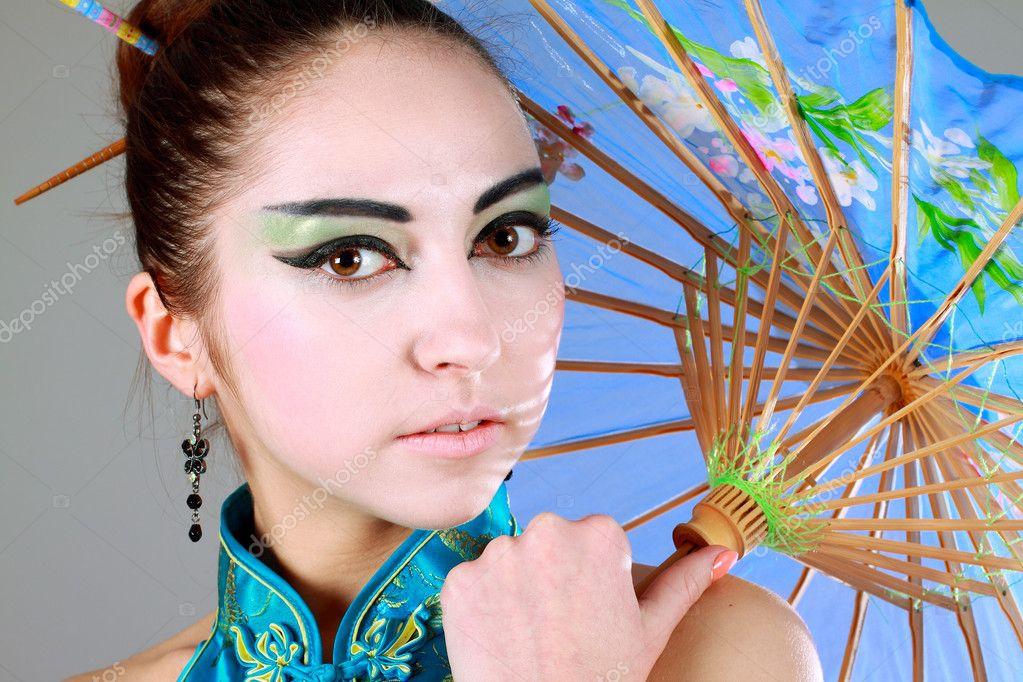 Young beautiful china girl with umbrella close up  Stock Photo #5314063