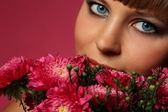 Portrait of beautiful girl with flowers — Stock Photo