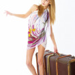 Stock Photo: Young woman with suitcase