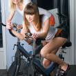 Stock Photo: Girls on bicycle