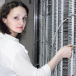 Stockfoto: Womworking on telecommunication equipment