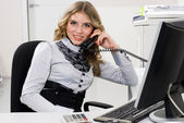 Businesswoman and phone — Stock Photo