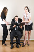 Businessman with assistants — Stock Photo