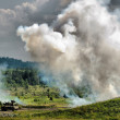 Smoke screen and tank - Stock Photo