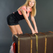 Beautiful girl with suitcase — Stock Photo