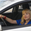 Stock Photo: Young woman in car