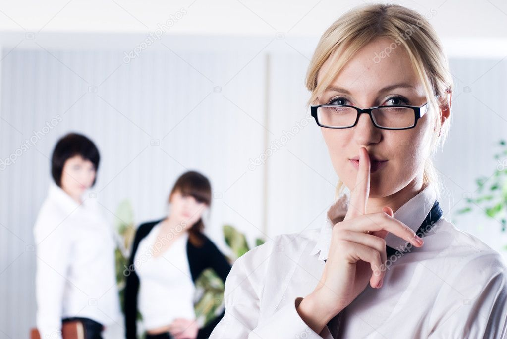 Woman with a Keep it quiet expression in office  Stock Photo #4141573