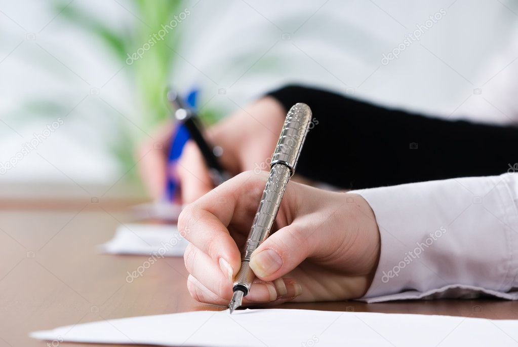 Female person's hand signing an important document — Stock Photo #4160527