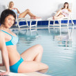 Young woman near pool - Stock Photo