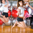 Girl in fitness center - Stock Photo