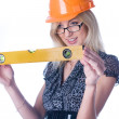 Woman in helmet with level - Stock Photo