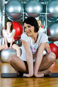 Girl in fitness center — Stock fotografie