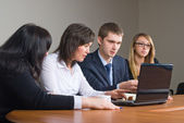 Businessgroup with laptop — Stock Photo