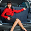 Woman in luggage compartment - Stock Photo