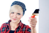 Young woman with paintbrush — Stockfoto
