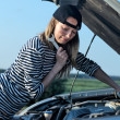 Young Blond Woman With Her Broken Car — Stock Photo #4265631