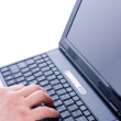 Male hand typing on a laptop — Stock Photo