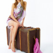 Young woman with suitcase — Stock Photo