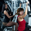Foto Stock: Girl in fitness center