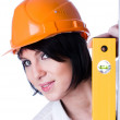Woman in helmet with level — Stock Photo #4279989