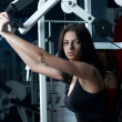 Young woman in sport club - Stock Photo