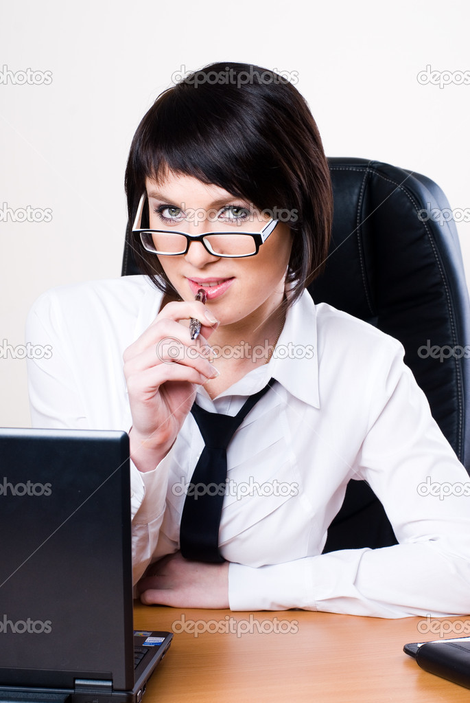Business woman working on a laptop at the office and smiling — Stock Photo #4314104