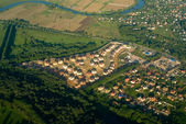 A view of a town or village seen from above — Stockfoto
