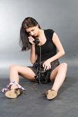 Woman and phone — Stockfoto