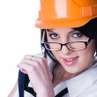 Woman in helmet wyh level - Stock Photo