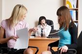 Businesswomen in office — Stock Photo