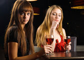 Young women with wine glass — Stockfoto