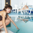 Foto Stock: Girl near pool