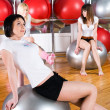 Girl in fitness center - ストック写真